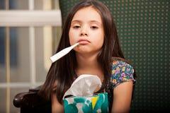 Mycket sjuk liten flicka Arkivbilder