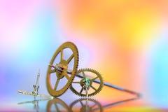 Mycket små klockakugghjul Arkivbilder
