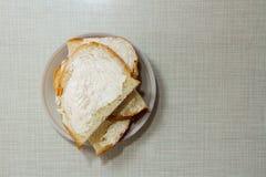 Mycket smaklig smörgås med smör royaltyfria bilder