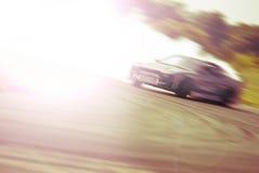 Mycket snabb körning, suddighetsdriva Arkivfoto