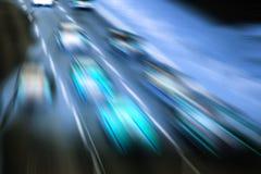 Mycket snabba bilar på huvudvägen Royaltyfri Fotografi