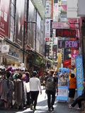 Myeong-dong Shopping Street. Myeong-dong is a very popular shopping area in Seoul, South Korea for tourists and locals alike Stock Photos