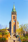 Myeongdong Cathedral Distant Steps Front People. Seoul, South Korea - July 4, 2015: Korean people walking down the front stairs of the imposing Catholic Stock Photos