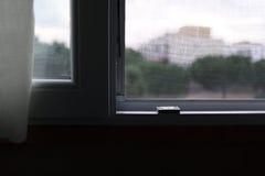Myggnät på ett PVC-fönster Royaltyfri Fotografi