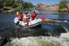 Group of adventurer enjoying water rafting activity at Southern Bug river. Mygiya / Ukraine - July 22 2018: Group of adventurer enjoying water rafting activity stock photos