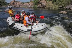 Group of adventurer enjoying water rafting activity at Southern Bug river. Mygiya / Ukraine - July 22 2018: Group of adventurer enjoying water rafting activity royalty free stock photography