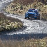 A car racing on the Myherin Rally track in Wales. Stock Photo