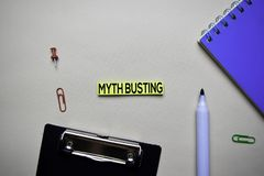 Myht Busting text on sticky notes with office desk concept. N stock photos
