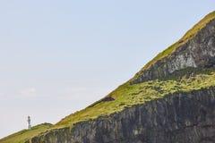 Mykines lighthouse and cliffs on Faroe islands. Hiking landmark