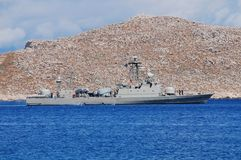 Mykonios missile boat, Greece. Hellenic Navy Combattante 111N class patrol boat Antipliarchos Mykonios, P23, departs Emborio harbour on the Greek island of Halki Stock Images
