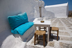 Mykonos. A coffee table is set in a street in Mykonos, in a decor made of blue and white, typical of the Greek Islands Stock Photography