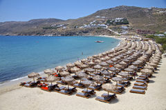 Mykonos Beach and Luxury beds Royalty Free Stock Image