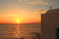 Mykonos church in sunset. Mykonos is a Greek island and a tourist destination, renowned for its cosmopolitan character and its intense nightlife Stock Images