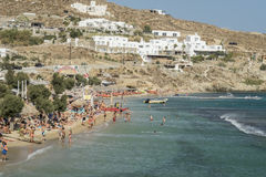 Mykonos, Greece - August 13 2016: Paradise beach filled with tourists. The beach opened to tourists in 1969 stock photography