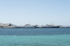 Mykonos, Greece - August 14 2016: The ships that cruise from Mykonos to Delos. Weather permitting, these ships conduct daily trips to the close island of Delos royalty free stock photo