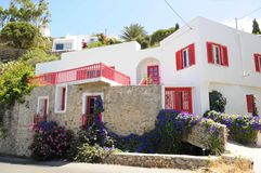 Mykonos, Greece. Home in Mykonos, Greece with pink and purple flowers adorning stone wall Royalty Free Stock Photography