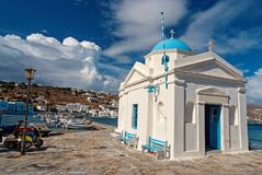 Mykonos, Greece - May 04, 2010: church building on sea quay with nice architecture. Agios Nikolaos church at seaside on stock images