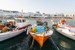MYKONOS, GREECE - MAY 2018: Fishermen boats moored in the port of Mykonos stock photo