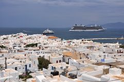 View over white houses of MYkonos town on greek island. Mykonos, Greece - May 2015: View over white houses of MYkonos town on greek island, in 2015, with a big Stock Image