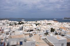 View over white houses of MYkonos town on greek island. Mykonos, Greece - May 2015: View over white houses of MYkonos town on greek island, in 2015, with a big Royalty Free Stock Photo
