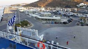 Mykonos, Greece - New port. Greek flag on a ship. stock video