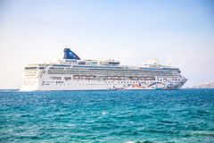 Mykonos, Greece - 17.10.2018: Norwegian Star is a cruise ship owned and operated by Norwegian Cruise Line shipyard in. Mykonos in Greece royalty free stock photography