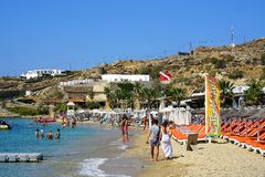 Mykonos, Greece, September 08 2018, Famous Paradise Beach full of young people looking for recreation royalty free stock photography