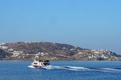 Mykonos, Greece, September 07 2018, Ferry Bus transports tourists from the new port to the old one royalty free stock photography
