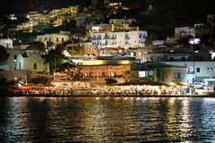Mykonos, Greece, September 07 2018, Picturesque evening view of Little Venice in Chora full of tourists from all the world royalty free stock photo