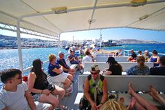 Mykonos, Greece, 11 September 2018, Tourists at the old port embark on special ferries to the island of Delos. Mykonos, Greece, 11 September 2018, Tourists at stock image