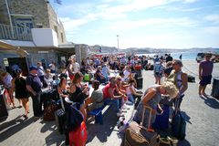Mykonos, Greece, 12 September 2018 Tourists of various nationalities waiting to embark on the various ferries that connect the. Cyclades Islands stock photo