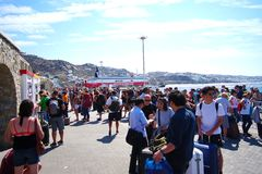 Mykonos, Greece, 12 September 2018 Tourists of various nationalities waiting to embark on the various ferries that connect the. Cyclades Islands royalty free stock image