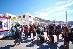 Mykonos, Greece, 12 September 2018 Tourists of various nationalities waiting to embark on the various ferries that connect the. Cyclades Islands stock photography
