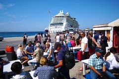 Mykonos, Greece, 12 September 2018 Tourists of various nationalities waiting to embark on the various ferries that connect the royalty free stock photo