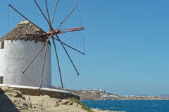 Mykonos, Greece. Traditional windmill with a view to Mykonos island. Over 16 windmills can be found in Mykonos royalty free stock image
