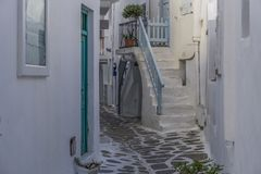Mykonos, Greece whitewashed alleys. Traditional dotted narrow alleys with painted doors and white stairs at Mykonos Town Chora Stock Photography