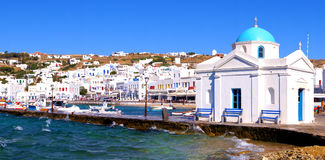 Mykonos harbor. Panoramic view of Mykonos harbor with traditional blue dome church, Greece Royalty Free Stock Image