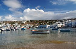 Mykonos island, Greece. View of harbor in Mykonos with clear water and boats royalty free stock images