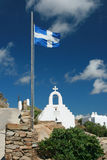 Mykonos Island - Greece. White Wash Chapel and Greek Flag Royalty Free Stock Photos