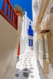 Mykonos old town street. Authentic whitewashed cycladic street in beautiful Mykonos island, Cyclades, Greece Royalty Free Stock Photos