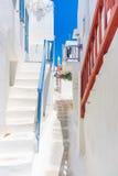Mykonos old town street. Authentic whitewashed cycladic street in beautiful Mykonos island, Cyclades, Greece Stock Photos