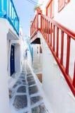 Mykonos old town street. Authentic whitewashed cycladic street in Mykonos island, Cyclades, Greece Royalty Free Stock Photos