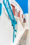 Mykonos old town street. White architecture with colorful stairs and windows in Mykonos old town, Cyclades, Greece Royalty Free Stock Photos