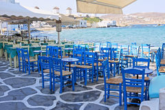 Mykonos Patios. Chairs and tables of restaurants in the area of Little Venice in Mykonos island, Greece Royalty Free Stock Photography