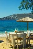 Mykonos restaurang på stranden Arkivfoton