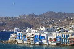 Mykonos seen from the sea. A corner of Mykonos seen from the sea with many seaside houses stock images