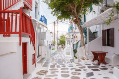 Mykonos town streetview with tree and red banisters, Mykonos town, Greece. Mykonos town streetview with tree and red banisters, Mykonos town royalty free stock photos