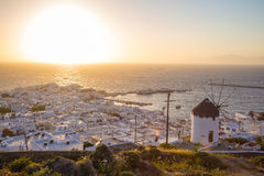 Mykonos town with windmill at sunset, Greece Royalty Free Stock Image