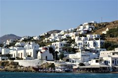 Mykonos, white houses, tourism and Greek island royalty free stock images