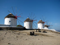 Mykonos Windmills. Side view of 4 of the famous 5 windmills in Mykonos main town, Mykonos Island, Greece, Europe Royalty Free Stock Image